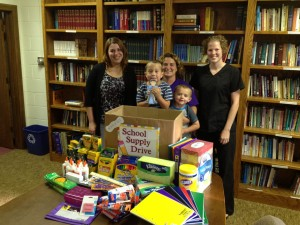 Pictured left to right are Charleston Community Day Care Center Parent/Teacher Committee members Kelly Simmonds, Camille Gordon and Rebecca Kai are pictured with the school supplies collected from CCDCC parents. Also pictured are Mrs. Gordon's two boys who both attend CCDCC.